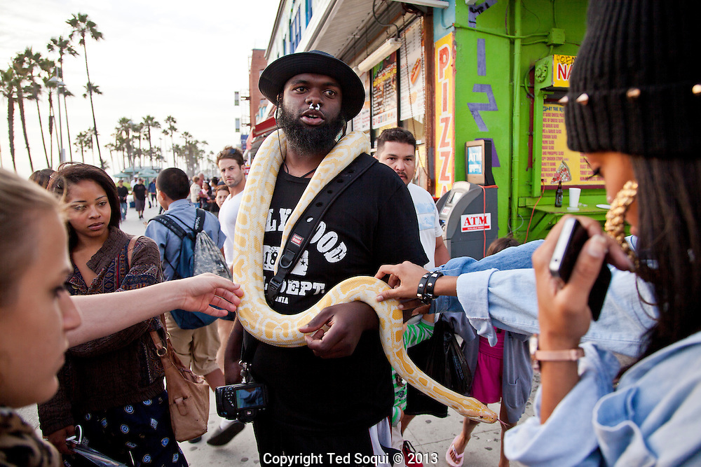 The Snake God with his albino Python snake.<br /> Scenes on the boardwalk of Venice Beach in Los Angeles