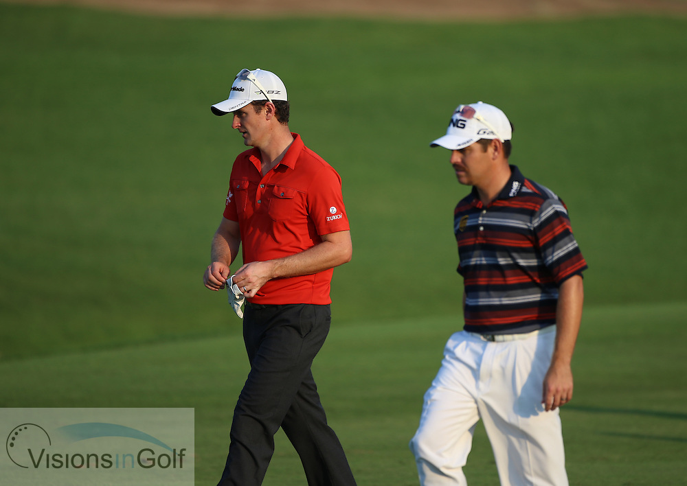 Justin Rose and Louis Oosthuizen<br /> at the DP World Tour Championship, Jumeirah Golf Estates Earth, Dubai UAE 2012<br /> Picture Credit:  Mark Newcombe / www.visionsingolf.com