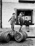 ..Revisit 1950s Ireland with an unforgettable .new collection of photographs from the Lensmen Photographic Archive..The 1950s Ireland in Pictures. ..Picture: Likely lads play on beer barrels in Castlebar 1952.. A unique collection of photographs that captures the essence of an important decade in Irish life and will bring back memories of the people, personalities, events - big and small - that shaped the period...Lensmen, Ireland's premier photographers, captured the essence of life in Ireland during the 1950s in their stunning and thought-provoking images. This new collection of their iconic photographs captures the 1950s in all its grit and glory and offers a fascinating insight into the cultural and political events of the decade. ..Established by Andrew Farren and Padraig MacBrian in 1952, Lensmen grew to become a substantial agency and this year celebrates 60 years in continuous business. Lensmen Photographic Agency is the oldest leading press and social photographer in Ireland and continues to grow.  The Lensmen Collection - licensed to irishphotoarchive.ie - contains a whole spectrum of images dating back to the early 1950s. It is comprised of almost 3 million images, documenting every aspect of life in contemporary Ireland...The 1950s: Ireland in Pictures captures a decade in Irish history: the world of entertainment and theatre, GAA, rugby, camogie, Presidents & Taoisigh, politics, religion, cycling, Olympic achievements, fashion, opera, shipping, horse-racing, show-jumping, saving the hay, weddings, fair days, farming, industry and much more...Christy Ring, Laurel & Hardy, Ronnie Delany, Tom Barry, Josef Locke, Noel Purcell, Maeve Kyle, Leo Rowsome, Cyril Cusack, Siobhan McKenna, Vivien Leigh, Noel Coward, Micheal Mac Liammoir - from famous faces to the everyday, The 1950s: Ireland in Pictures features over 130 unforgettable images from throughout the decade...A unique tribute to the 1950s in Ireland and a stunning collection of evocative, stand-alone pho
