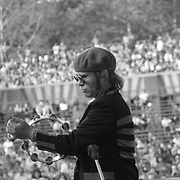 Elton John performs onstage with tambourine in Central Park at the Dr. Pepper Music Festival in 1977