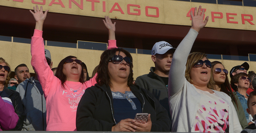 gbs041617f/ASEC -- People raise their hands in praise during a song at the Calvary Albuquerque's  Easter Sunrise Service: Against All Odds on Sunday, April 16, 2017. (Greg Sorber/Albuquerque Journal)