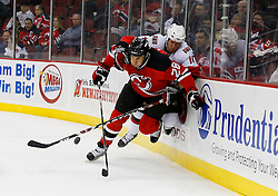 Jan 4, 2008; Newark, NJ, USA; Ottawa Senators right wing Shean Donovan (10) hits New Jersey Devils defenseman Jay Leach (28)  during the first period at the Prudential Center.