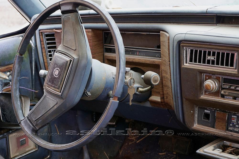 Cadillac classic car steering wheel, speedometer, and ergonomics.