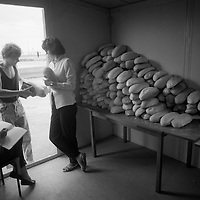 Bread being handed out in a refugee camp in Cepin, Croatia.