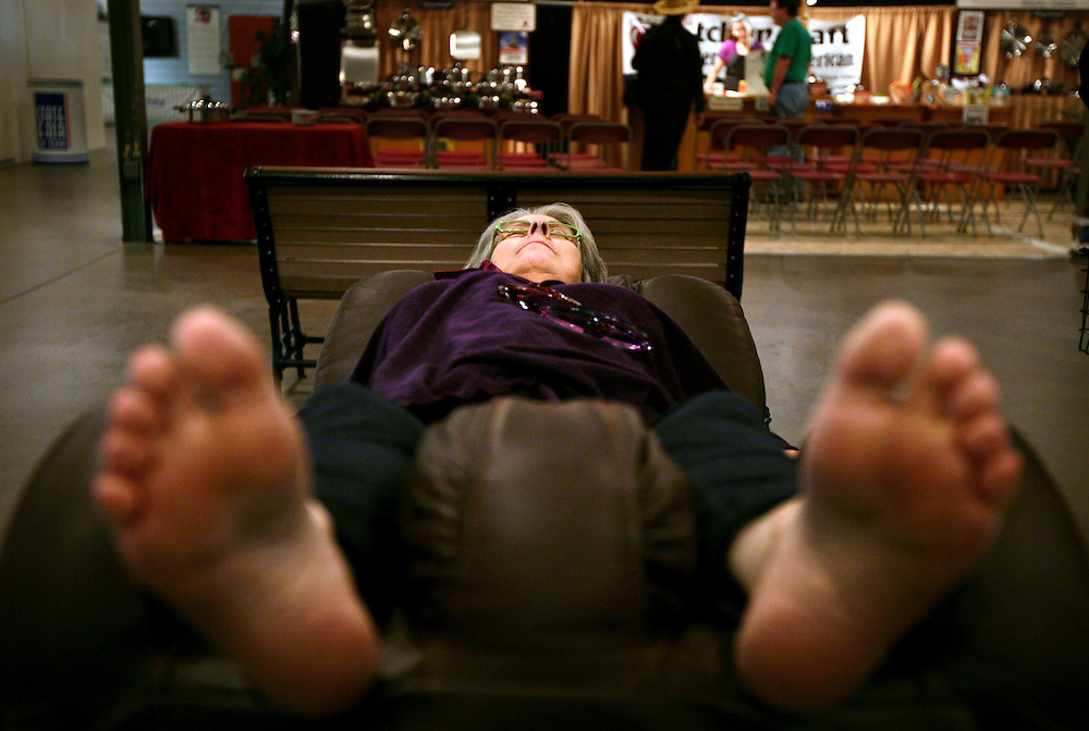 Mona Grundy kicks back in a Massagenius, Inc., body massaging chair at the State Fair of Texas October 14, 2010. The Massage Genius booth, which sells the chairs, has been at the fair for 15 years and tends to get repeat visitors, for obvious reasons.
