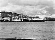 """Supertrawler arrives at Killybegs..1986..17.05.1986..05.17.1986..17th May 1986..""""Atlantic Challenge"""" the new IR£6million supertrawler,the flag ship of the Irish fishing fleet arrived at Killybegs today. The vessel was built for Killybegs' Enterprises in Bergen,Norway. Killybegs' Enterprises also have """"Western Viking"""".""""Jasper Sea"""" and""""Silver King""""supertrawlers in their fleet..The vessel will be skippered by Mr Martin Howley who originally trained with B.I.M.s National Fishery Training Centre, Greencastle..The company plans to fish for non-quota stocks such as Blue Whiting and Horse Mackerel,her fishing pattern will lessen dependence on mackerel as quotas are low for the Irish fleet...A view from across the harbour of super trawler """"Atlantic Challenge as she lies moored."""