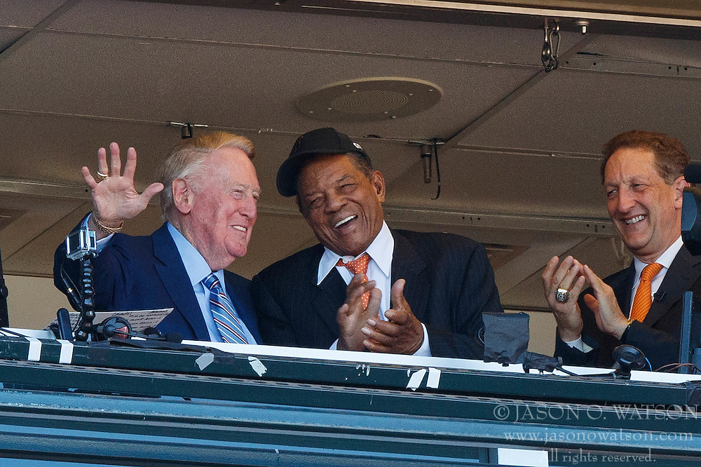 SAN FRANCISCO, CA - OCTOBER 02: Los Angeles Dodgers broadcaster Vin Scully is congratulated on the last game of his 67-year career by hall of famer Willie Mays and San Francisco Giants CEO Larry Baer during the fourth inning at AT&T Park on October 2, 2016 in San Francisco, California. The San Francisco Giants defeated the Los Angeles Dodgers 7-1. (Photo by Jason O. Watson/Getty Images) *** Local Caption *** Vin Scully; Willie Mays; Larry Baer