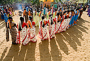 Sri Lanka. Womens festival at Udappuwa. The first festival after the Sinhala Tamil New year, in the hot month of April or May. They dance in groups around a shrine at night and the next morning. On the Wednesday* morning, they all converge on the beach, carrying with them pots with seedlings and end the celebration with an offering to the sea. An adaptation of a harvest &amp; rain festival, at this fishing community the prayer is for a better catch from the sea. .*The festival is always on a Tuesday evening and Wednesday morning.<br /> Sri Lanka.