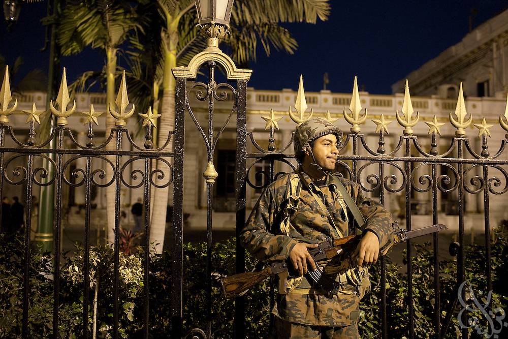 An Egyptian Army soldier stands guard during a demonstration by more than 1000  protesters outside the gates of the Parliament building February 08, 2011 in Cairo, Egypt. The numbers of protesters in and around Tahrir swelled again today after a few days where it seemed momentum had been lost and the crowds were thinning. .Slug: Egypt.(Photo by Scott Nelson)