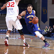 Santa Cruz Warriors Forward Mychel Thompson (15) dribbles past Delaware 87ers Forward Drew Gordon (32) in the second half of a NBA D-league regular season basketball game between the Delaware 87ers and the Santa Cruz Warriors (Golden State Warriors) Tuesday, Jan. 13, 2015 at The Bob Carpenter Sports Convocation Center in Newark, DEL