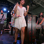 Edward Sharpe and the Magnetic Zeros featuring Alex Ebert (vocals, guitar, percussion, piano), Jade Castrinos (vocals, guitar), Nico Aglietti (guitar, synthesizer, keyboards, vocals), Stewart Cole (trumpet, percussion, keyboards, tenor ukulele, vocals), Tay Strathairn (piano, vocals) Aaron Older (bass, vocals, banjo, percussion), Josh Collazo (drums, percussion, vocals), Orpheo McCord (percussion, vocals), Nora Kirkpatrick (accordion, vocals), and Christian Letts (guitar, vocals) performs during the second day of the 2010 Bonnaroo Music & Arts Festival on June 10, 2010 in Manchester, Tennessee. The four-day music festival features a variety of musical acts, arts and comedians..Photo by Bryan Rinnert