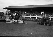 RDS Horse Show. Dundrum, with Tommy Wade up, clears the tricky wate jump on his final round before going into the last fence to clinch the victory for Ireland..08.08.1963