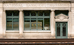 The National Bank of Thurmond located in the mostly abandoned town of Thurmond, West Virginia is part of the New River Gorge National River, which is administered by the National Park Service. During the height of coal mining in the New River Gorge, Thurmond was a properous town with banks and other businesses.