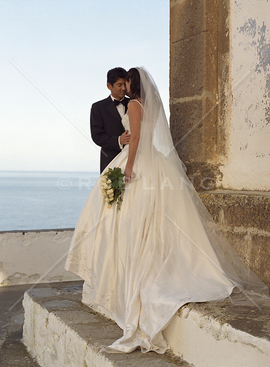 bride and groom standing on stairs in Positano, Italy