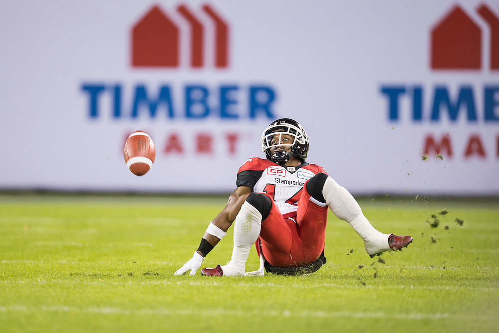 Roy Finch of the Calgary Stampeders slips as he tries to receive a punt during the 1st quarter of the 104th Grey Cup against the Ottawa Redblacks in Toronto Ontario, Sunday,  November 27, 2016.  (CFL PHOTO - Geoff Robins)
