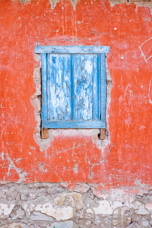 The bright colours of a wall and window on an Andean village adobe house.  The image is available for commercial licensing through Arcangel Images. ID# AA1646365 . Contact LOxArte for Fine Art Prints.