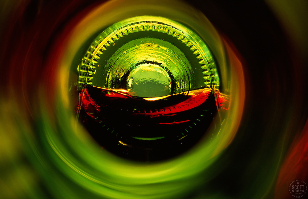 """""""Beauty at the Bottom: Red Wine 1""""- This image is a photograph of a wine bottle shot right down the mouth of the bottle. A television provides the main light source"""