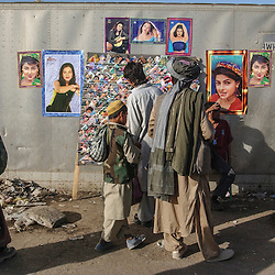 Money changers and life in the central market  in Kabul, Afghanistan August 5, 2002.  (Photo  by Ami Vitale)