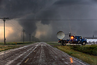 Scientists in the Doppler on Wheels 5 radar truck operated by the Center for Severe Weather Research scan a nearby tornado, May 24, 2016, south of Dodge City, Kansas.