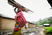 Displaced people camp nearby Nyanzale. <br /> &lsquo;&rsquo;We make a living out of this saw. Trees are expansive, it&rsquo;s hard, but at the same time there is hope for all of us. My wife was killed, I came here empty-handed and can hardly remember the route, I was shocked. Now if I keep selling boards, I can earn a little bit of money and live.