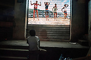 """Projection of the photographic series """"Rio Baile Funk"""" during a """"Funk event, here in favela Santa Marta, South area of Rio de Janeiro. After years documenting and photographing the bailes funk (funk balls), it seemed only fair to show this work where it actually took place..Santa Marta's favela is experimentally occupied by the military police (UPP project) since early 2009, after 30 years of domination of the drug dealers & gang war..Despite of the recent new """"security"""", Baile Funk remain prohibited. This slideshow took place during a Funk event / protest organized by the APAFUNK association, struggling for the legalization and recognizing of the Funk Carioca culture.."""