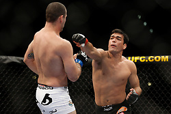 October 24, 2009; Los Angeles, CA; USA; Lyoto Machida (black trunks) throws a right hand at Mauricio Rua(white trunks) during their UFC light heavyweight championship bout at UFC 104.   Machida won via controversial unanimous decison .  Mandatory Credit:  Ed Mulholland
