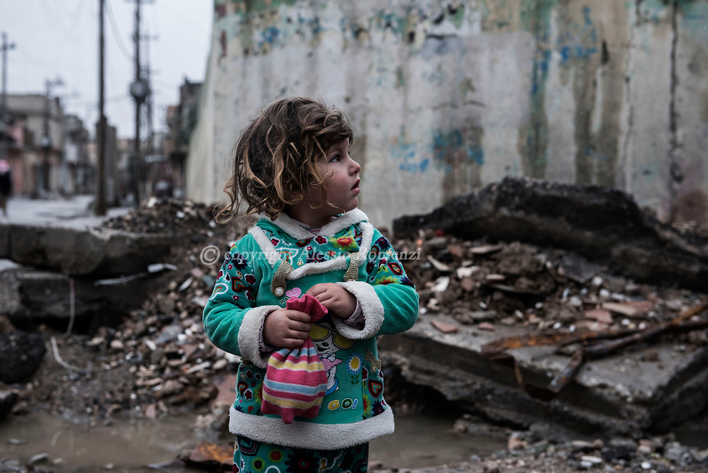 Iraq, Mosul: A child is seen in a newly liberated area in west Mosul. Alessio Romenzi