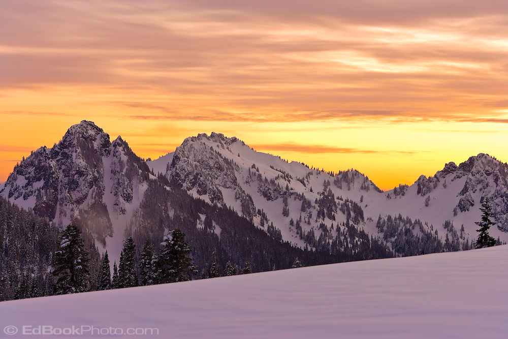 evening alpenglow lights the winter sky over the Tatoosh Range in Mount Rainier National Park, Cascade Mountain Range, Washington, USA