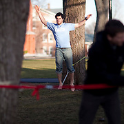20110317 - Medford/Somerville, Mass. -  Ryan Hofstetter (E11) walks on a slack line for balance training on the academic quad before Nick Levin (A11) and Ryan Stolp's (A11) ExCollege mountaineering class on March 17, 2011...(Kelvin Ma/Tufts University)