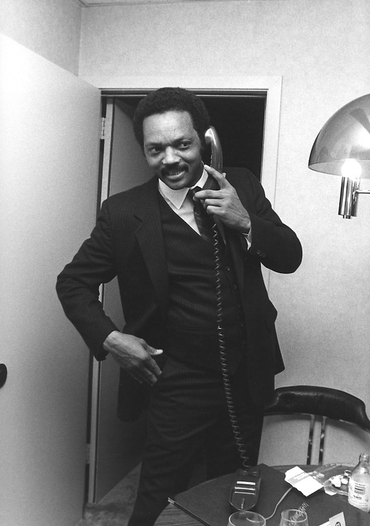 Reverend Jesse Jackson makes a call from his hotel room as he campaigns across the south in his 1984 bid to be the first African American president of the United States.