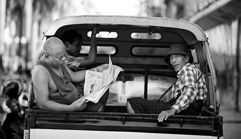 Keeping up with the news in Yangon, Myanmar.