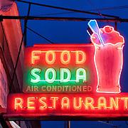 Neon illuminated Food Soda sign