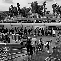 Pedestrians wait in line to cross the U.S.-Mexico border in Tijuana, Mexico on Sunday, March 3, 2013.  Due to the recent Sequestration cuts, Customs and Border Patrol agents have been given reduced hours leading to longer lines at the World's most busy border crossing.