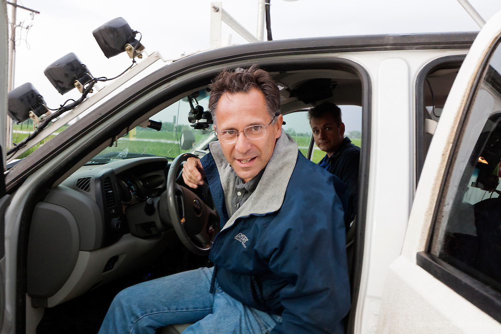 Scientist Tim Samaras and storm chaser Carl Young exit their chase vehicle in central Nebraska, June 1, 2011.  Tim and Carl were two of the first chasers ever killed in a tornado on May 3, 2013.