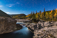 Stars over Elbow Falls in the Kananaskis area of southern Alberta, shot under the light of the gibbous Moon on the last night of summer, September 22, 2015. The aspens were in full fall foliage on a very clear, mild night. <br /> <br /> This is a stack of 6 images, one for the sky and 5 for the ground, with the latter median combined to smooth noise. All were shot with the 24mm lens at f/4 and Nikon D750 at ISO 1250 for 30 seconds each. I painted the falls with an LED light for a few seconds to better illuminate the water that was in shadow.