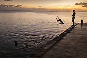 Diving off Sugar Dock in Saipan's lagoon at the end of the day. It's the local swimming spot.