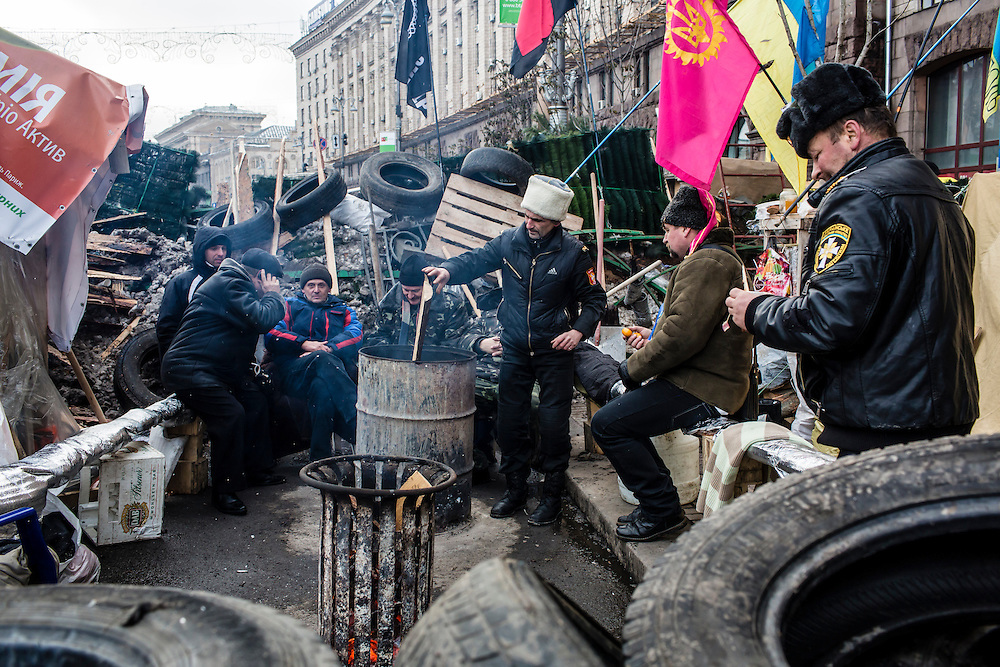 KIEV, UKRAINE - DECEMBER 13: Anti-government protesters are dug in to makeshift camps along the edges of Independence Square, which they have occupied for over three weeks, on December 13, 2013 in Kiev, Ukraine. Thousands of people have been protesting against the government since a decision by Ukrainian president Viktor Yanukovych to suspend a trade and partnership agreement with the European Union in favor of incentives from Russia. (Photo by Brendan Hoffman/Getty Images) *** Local Caption ***