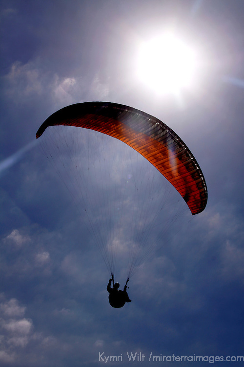 USA, California, San Diego. Paraglider, Clouds and Sun.