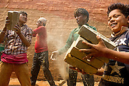Young men and boys stack bricks inside a kiln on April 14, 2016 in Dharke Bazar in the Dhading district, Nepal. Despite a national law that bans children under the age of 14 from working, many work alongside their families in the country's brick making industry. <br /> Ann Hermes/&copy; The Christian Science Monitor 2016