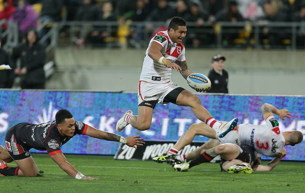 Peter Mata`utia of the Dragons beats Ken Maumalo of the New Zealand Warriors on his way to score a try during their round 22 NRL match at Westpac  Stadium, Wellington on  Saturday, August 08, 2015. Credit: SNPA / David Rowland