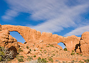 South and North Windows are comprised of the Slick Rock member of Entrada Sandstone on top of the red-brown. or chocolate-brown marker beds of the Dewey .Bridge member, in Arches National Park, Utah, USA. These rock monuments are beautiful both at sunrise (seen here) and sunset.