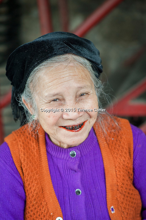 A woman with blackened teeth in the markets of Sapa, Vietnam.
