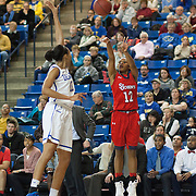 St. John's Guard Briana Brown (12) shoots a 3-point shot as Delaware Center Kelsey Buchanan (13) defends in the second half of a NCAA regular season non-conference game between Delaware (CAA) and St. John's (Big East) Monday, Dec 30, 2013 at The Bob Carpenter Sports Convocation Center in Newark Delaware.