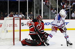 Feb 9, 2009; Newark, NJ, USA; New York Rangers center Chris Drury (23) looks for the rebound after a save by New Jersey Devils goalie Scott Clemmensen (35) during the first period at the Prudential Center.