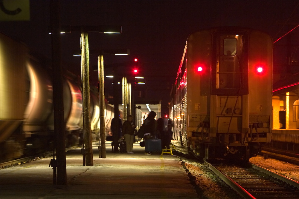A few passengers line up to board the southbound Amtrak train City of New Orleans on the platform in Homewood, IL.