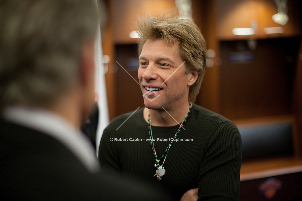 """Jon Bon Jovi at a meet-and-greet. """"12-12-12?, a fundraising concert to aid the victims of Hurricane Sandy, will take place on December 12, 2012 at Madison Square Garden. The concert featured The Rolling Stones, Bon Jovi, Eric Clapton, Dave Grohl, Billy Joel, Alicia Keys, Chris Martin, Bruce Springsteen & the E Street Band, Eddie Vedder, Roger Waters, Kanye West, The Who, and Paul McCartney. All the proceeds went go to the Robin Hood Relief Fund. Robin Hood, the largest independent poverty fighting organization in the New York area, will insure that every cent raised will go to non-profit groups that are helping the tens of thousands.of people throughout the tri-state area who have been affected by Hurricane Sandy...Photo © Robert Caplin.."""