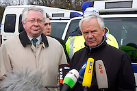 03 JAN 2005, LUDWIGSFELDE/GERMANY:<br /> Ernst Vorrath (Mi L), Praesident des Bundesamtes fuer Gueterverkehr, und Manfred Stolpe (Mi R), SPD, Bundesverkehrsminister, geben ein Pressestatement, waehrend dem besuch einer Mautkontrolle, Parkplatz Fresdorfer Heide<br /> IMAGE: 20050103-01-016<br /> KEYWORDS: Bundesamt f&uuml;r G&uuml;terverkehr, LKW Maut, Mikrofon, microphone<br /> BAG