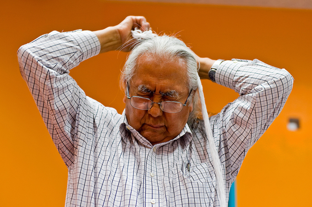 """050510       Brian Leddy.Ralph Bennett concentrates on tying a traditional hair tie on Wednesday at the Navajo Nation Museum. """"Once I learn this I'm gonna travel alone,"""" Bennett said."""