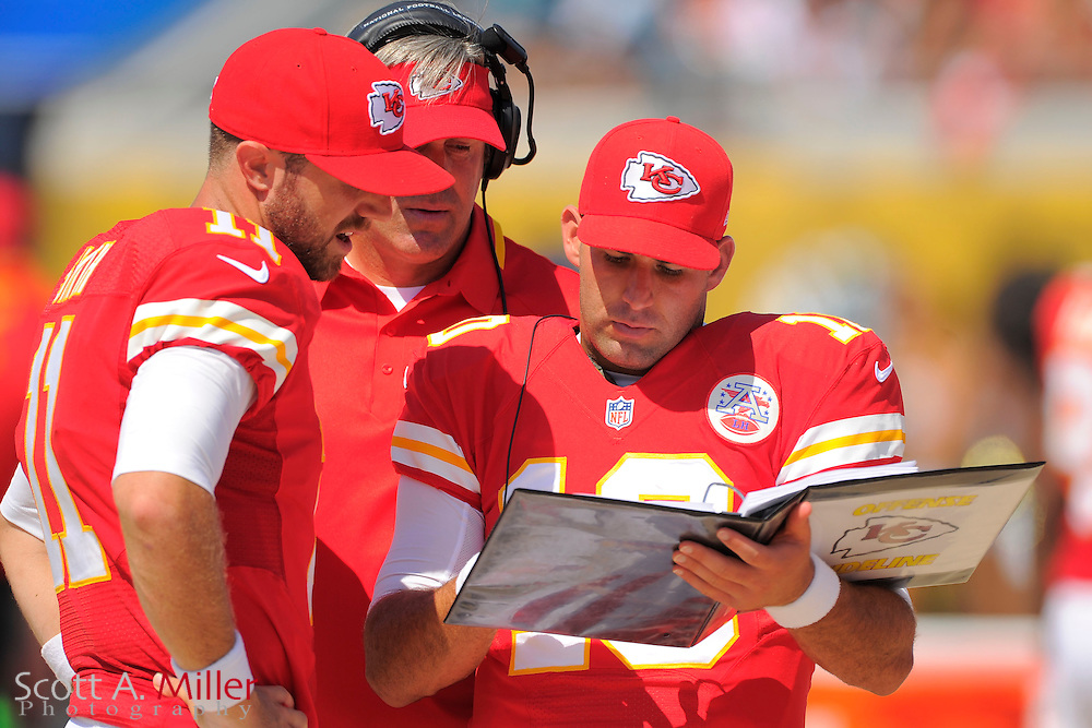 Kansas City Chiefs quarterback Alex Smith (11), quarterback Chase Daniel (10) and Offensive Coordinator Doug Pederson on the sidelines during the Chiefs 28-2 win over the Jacksonville Jaguars at EverBank Field on Sept. 8, 2013 in Jacksonville, Florida. The <br /> <br /> &copy;2013 Scott A. Miller