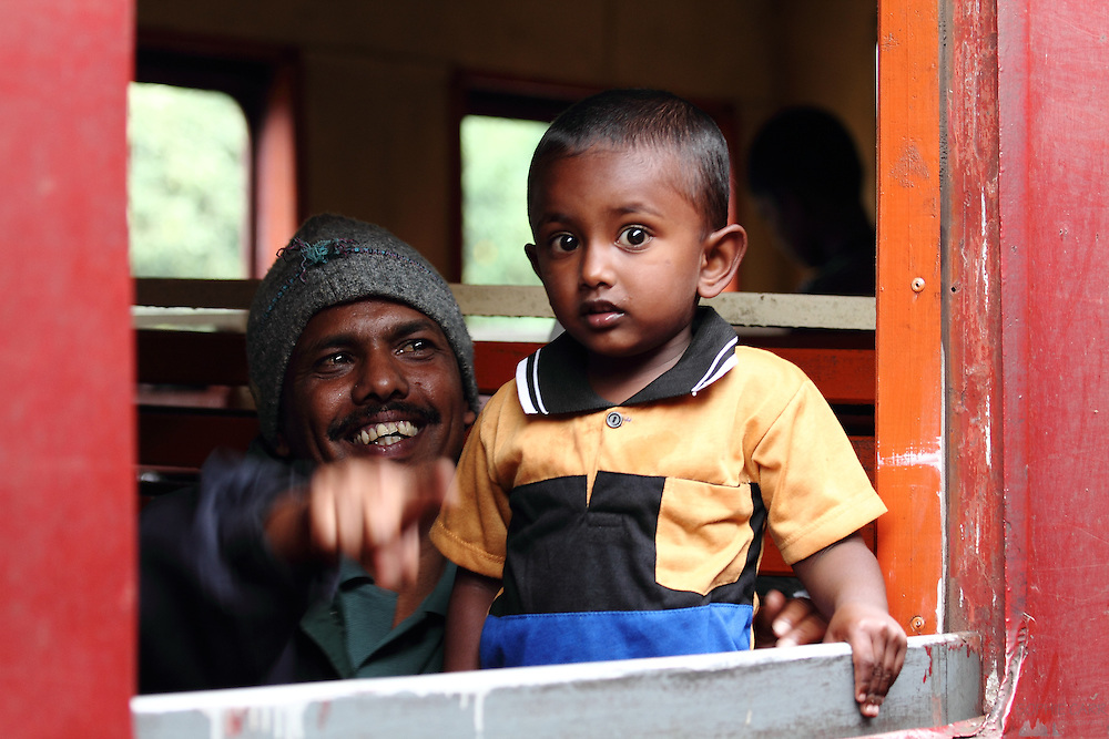 A man and his son see me as we pass by in a station between Kandy and Ella in Sri Lanka's hill country